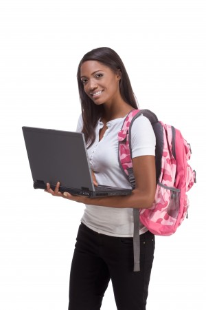 student with backpack and laptop